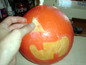applying-face-to-paper-mache-pumpkin.jpg