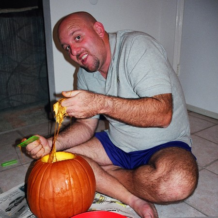 Jim cleaning out the pumpkin guts.