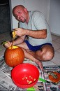 Jim carving out the goo from the inside of a pumpkin