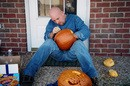Jim using a template to carve a pumpkin.