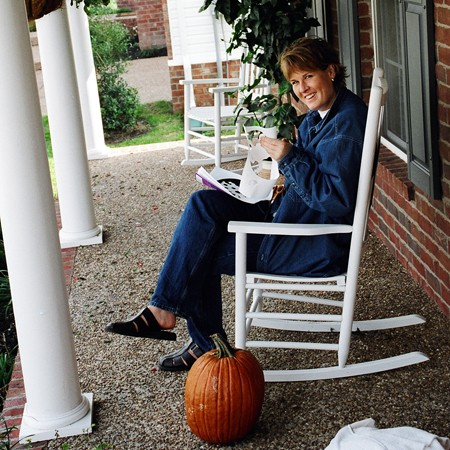 Lynnette cutting out templates for carving pumpkins.