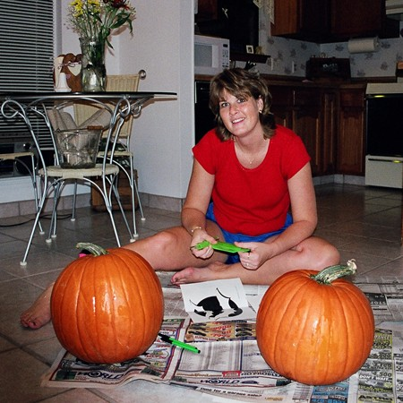Lynnette using all the right to carve pumpkins.