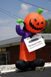 Halloween pumpkin inflatible yard art in front of a Franklin, Tennessee sub shop.