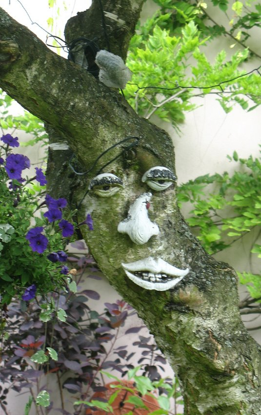 This is an example of a really unique tree face... with flowers. See how to make your own tree face art, talking trees, and more!