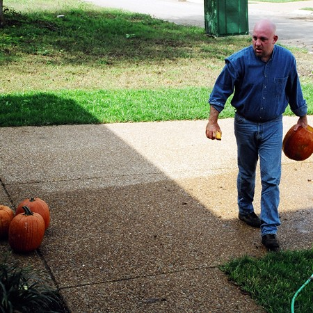 Jim washing out the pumpkins we've chosen to carve.