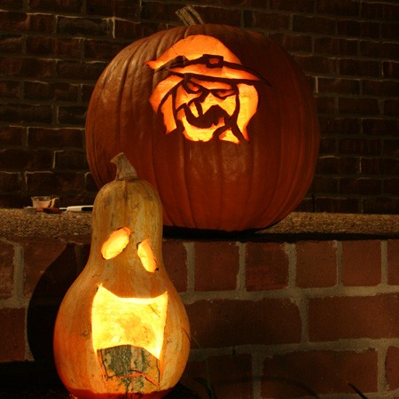 We used our old standby witch pumpkin carving template, and free-hand carved faces on the gourds.