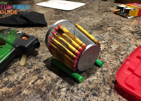 I used modeling clay to secure the wire mesh pencil holder in place while gluing the crayons onto it.